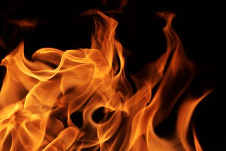 hellish: Fire flames texture over black background  Stock Photo
