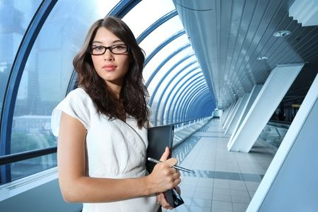 Confident young businesswoman in futuristic interior. photo
