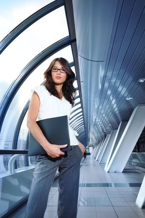 Beautiful young businesswoman in futuristic interior