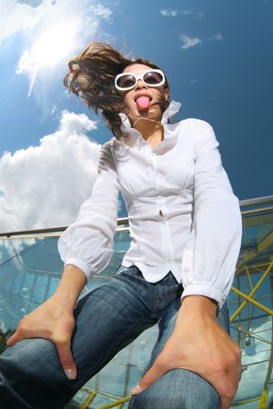 unusual angle: Fun wide angle portrait of young woman in blue jeans