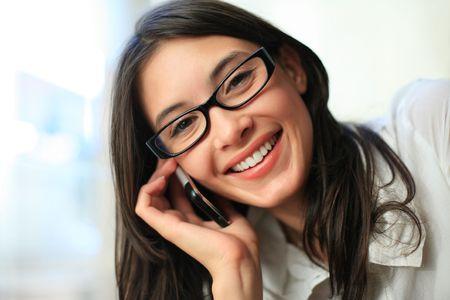 teeths: Beautiful woman talking on cell phone