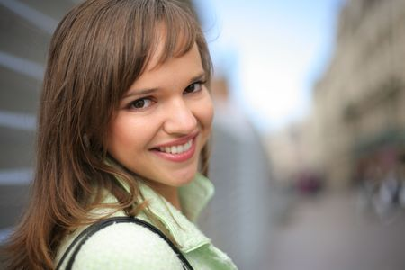 Portrait of happy beautiful young woman in city. Close-up, shallow DOF. Stock Photo - 5947187