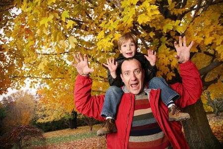 family photo: Father and son in autumn park