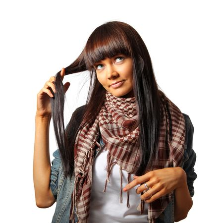 fringe: Beautiful young brunette woman touching her long hair. Isolated over white. Stock Photo