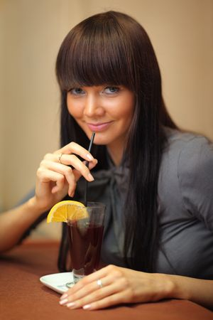 Beautiful young woman drinking mulled wine. photo