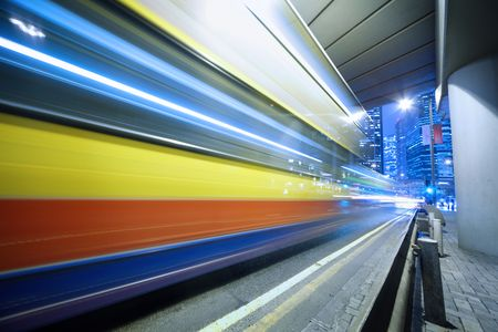 Bus speeding through night street. Hong Kong, China. Stock Photo - 6387541