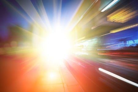 Bus speeding through city street. Abstract futuristic background photo