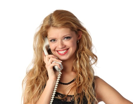 Beautiful young woman talking on the phone Stock Photo - 7138902
