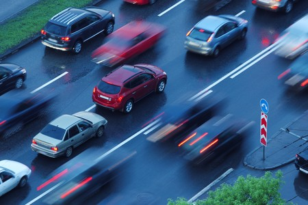 lane lines: Cars moving over wet road background. Blurred motion. Stock Photo