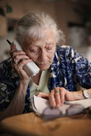 Senior woman talking on the phone. Close-up, shallow DOF.