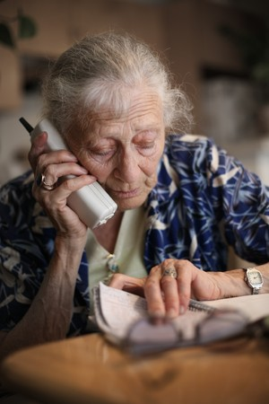 aging woman: Senior woman talking on the phone. Close-up, shallow DOF.