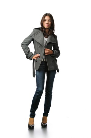denim jacket: Beautiful fashion model in autumn clothes isolated on white background Stock Photo