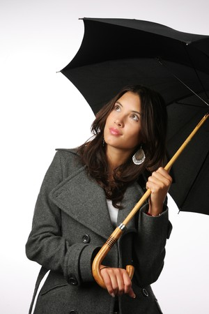 Beautiful Asian woman with umbrella against white background photo