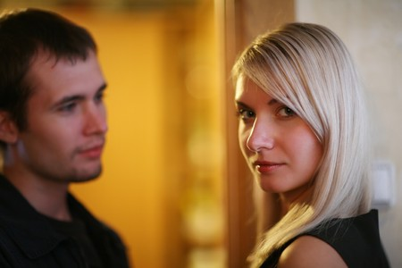 approaching: Woman and man in relationship. Shallow DOF.