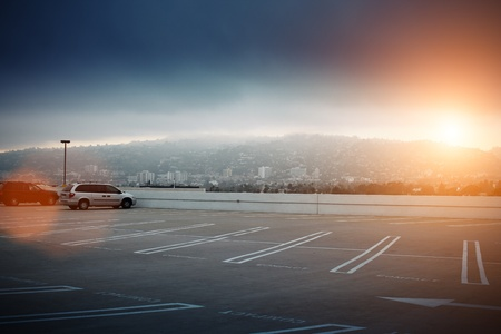 cars parking: Big empty parking lot space ontop of roof in Los Angeles, California. Stock Photo