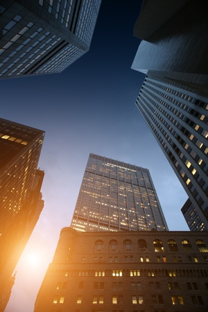 Sunrise seen through rising skyscrapers in downtown Manhattan, New York, NY, USA. Stock Photo - 8393378