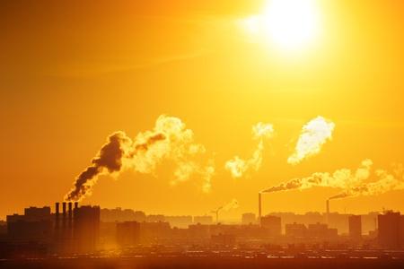 smokestacks: Industrial factory smoke from smokestacks over sunset sky