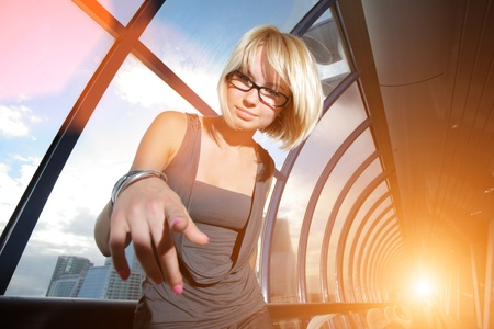 Young businesswoman pointing in camera photo