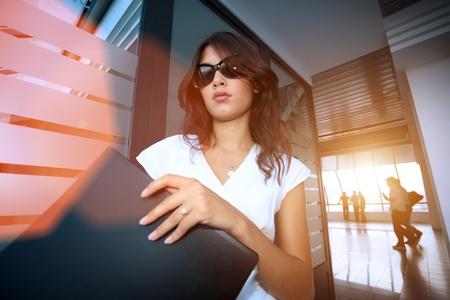 Bautiful young businesswoman in futuristic interior photo