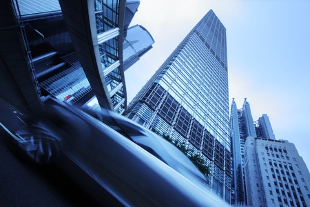 Modern city architecture. Wide angle view from below on skyscrapers, bridge and moving cars. Stock Photo - 8393604