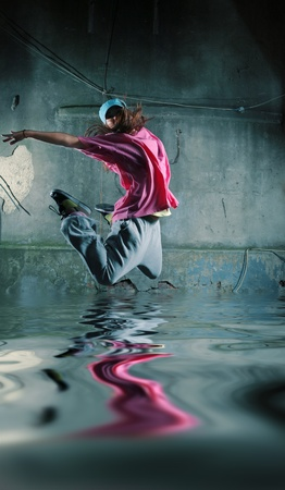reflects: Modern dancer jumping over water