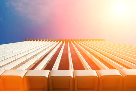 Generic office building rising to bright sunny sky. Copyspace. Stock Photo - 8393341