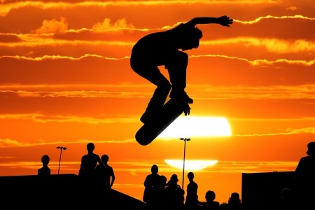 Jumping skateboarder silhouette Stock fotó
