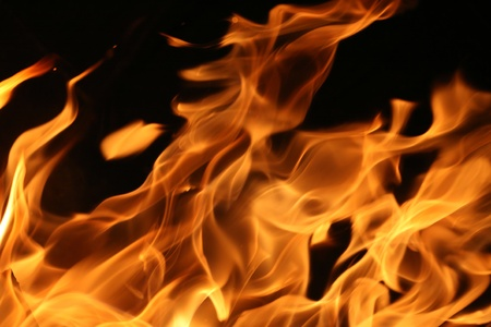 Hot blazing fire abstract background photo