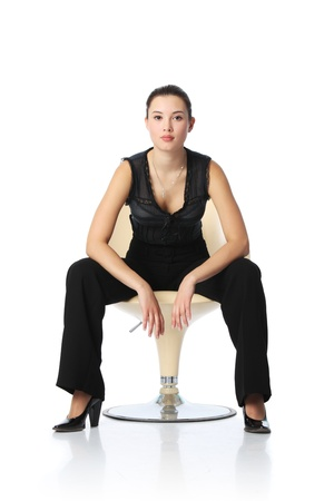 Asian businesswoman in black pants sitting in chair, isolated on white background photo