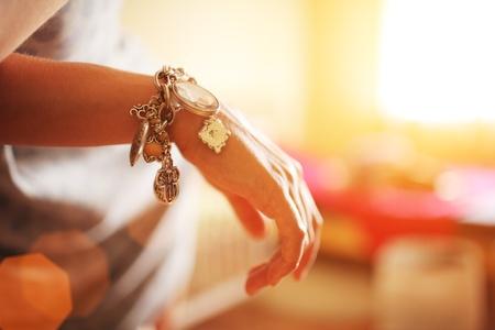 silver jewelry: Female hand with silver bracelet jewelry. Closeup, shallow DOF. Stock Photo