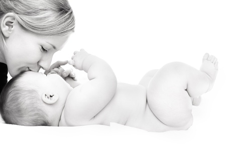 blonde mom: Happy mother kissing baby girl against white background Stock Photo