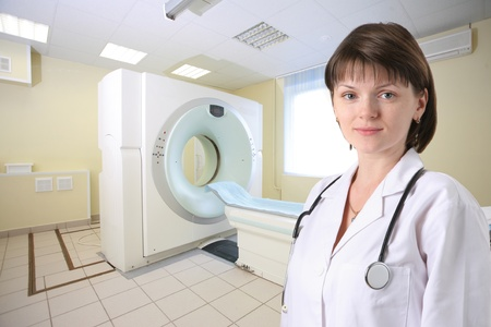 ct: Female doctor in CT Scanner room