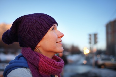 Portrait of happy young woman in city. Shallow DOF. photo