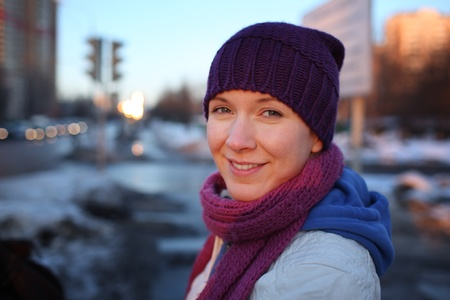 winter woman: Portrait of happy young woman in city. Shallow DOF. Stock Photo