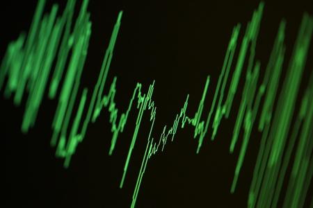 Audio, seismic or stock market wave diagram. Macro closeup, shallow DOF. Imagens