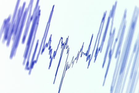 earthquake: Audio, seismic or stock market wave diagram. Macro closeup, shallow DOF. Stock Photo