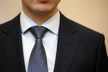 suit tie: Closeup portrait of businessman in white collar shirt and suit with tie. Stock Photo