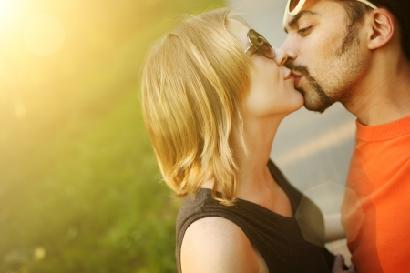 Couple in love kissing outdoors. Copyspace. photo