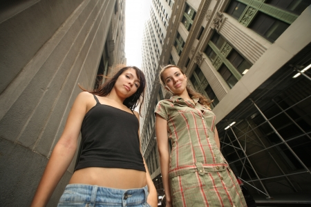 Two beautiful young women in New York City street. Wide angle. photo