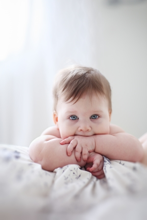 Portrait of baby girl, thinking. Closeup. photo
