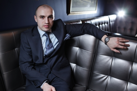 expensive: Portrait of handsome bald business man in suit in luxury interior. Stock Photo