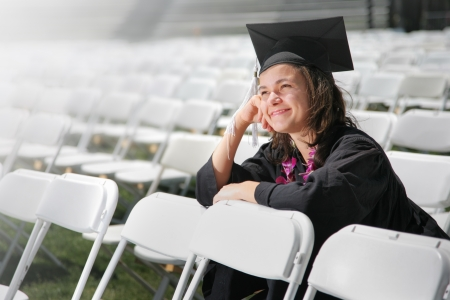 imagining: Happy graduate daydreaming. Closeup, shallow DOF.
