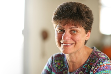 dof: Portrait of happy mature woman at home. Closeup, shallow DOF.