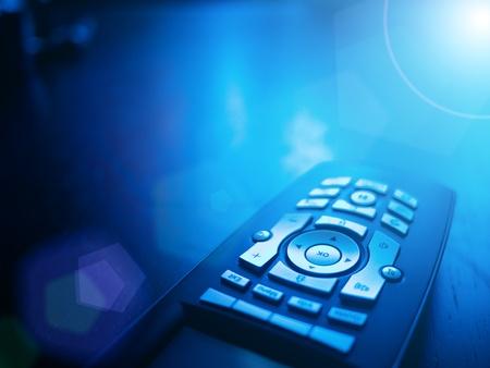 Media tv remote control on blue background, closeup. Copyspace.