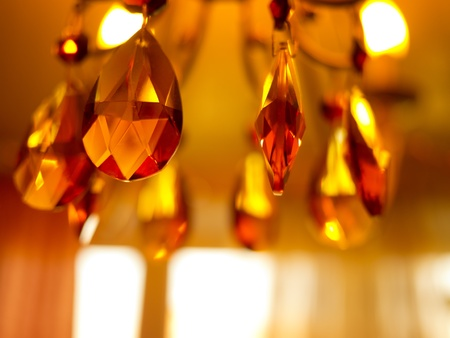 Chrystal yellow chandelier close-up photo