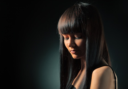 straight hair: Portrait of beautiful model with long straight hair over dark background.