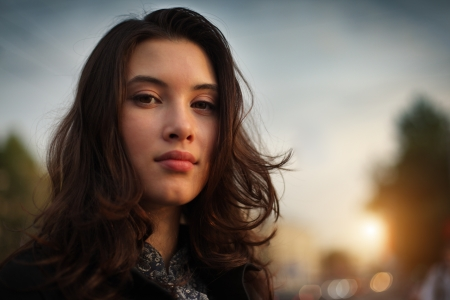 Portrait of beautiful Asian woman in city, closeup on face. photo