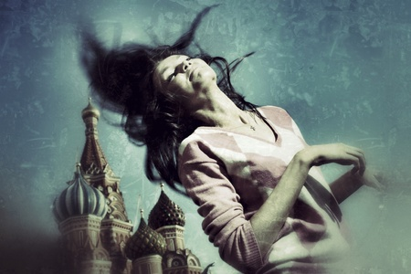 square dancing: Happy woman waves long hair over  vintage grunge background at Red Square, Moscow, Russia. Stock Photo