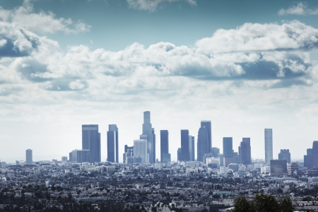 Downtown Los Angeles skyline over blue cloudy sky. Stock Photo