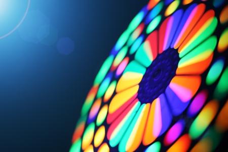 Illuminated colorful spinning wheel, motion blur background.